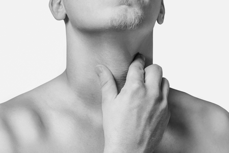 tonsillitis: Man holds the throat, sore throat. Monochrome image, isolated on a white background Stock Photo