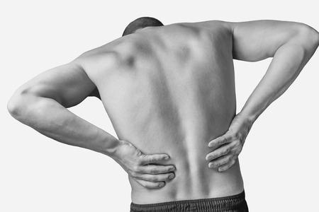 Akute Schmerz in einem männlichen unteren Rücken. Monochromes Bild, isoliert auf einem weißen Hintergrund Standard-Bild