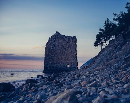 sail: Rock Sail on pebble coast of Black sea in evening at sunset, Gelendzhik town, Russia