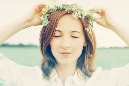 yellow wildflowers: Beautiful woman with closed eyes with wreath of yellow wildflowers on her head in summer
