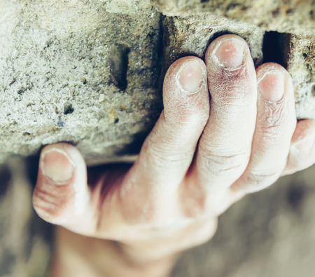 magnesia: Close-up of climber male hand in magnesium powder on stone rock outdoor