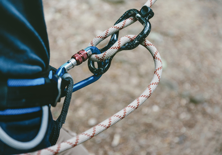 Female climber in harness with rope and figure eight. Stock Photo
