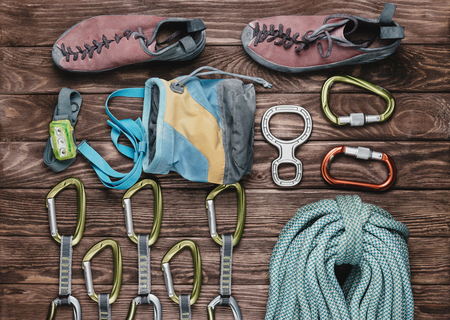 Equipment for climbing sport on wooden background, top view. Banco de Imagens - 83075158