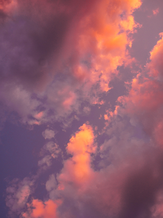 Background of sunset sky and clouds in blue and pink colors. Stock Photo