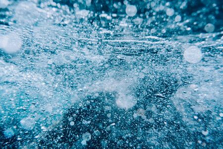 Abstract water texture with many air bubbles.