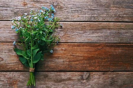 Bunch of beautiful Forget-me-not flowers on wooden background Stock Photo