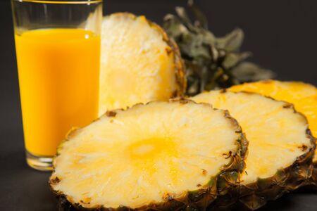 Pineapple juice on black background