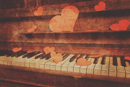 Piano with paper hearts, Valentines Day. Vintage image