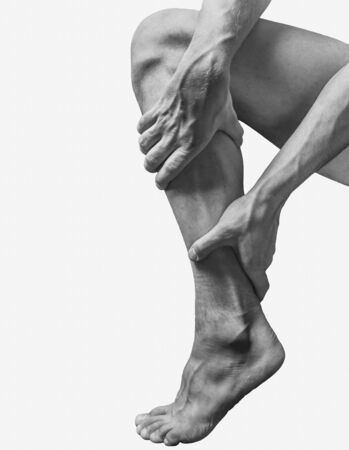 Acute pain in the male calf muscle. Monochrome image, isolated on a white background Stock Photo - 128454548