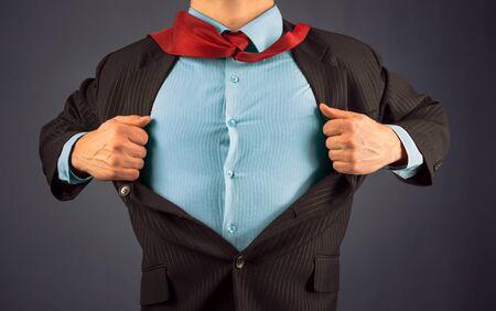 Unrecognizable business man opens suit showing blue shirt, space for text