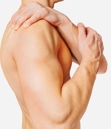 Unrecognizable shirtless man compresses his shoulder, pain in the shoulder. On a white background