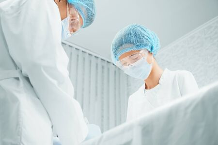 Male and female surgeons are working in operating room, teamwork