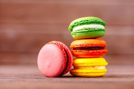 Stack of colorful macarons dessert on a wooden background. Stok Fotoğraf