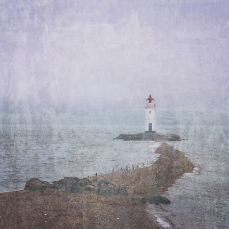Lighthouse on rocky coast, image with old textured effect