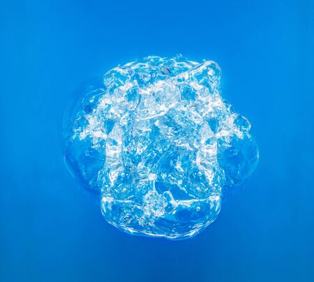 Big bubble in blue water, top view Banco de Imagens