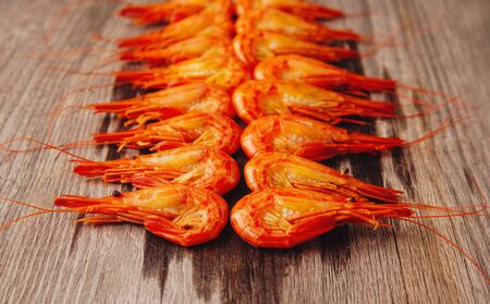 Boiled shrimps on wooden background, side view Stok Fotoğraf