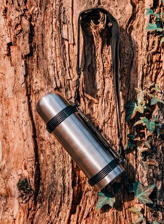 flask hanging on a tree. Hiking and travel theme Banco de Imagens