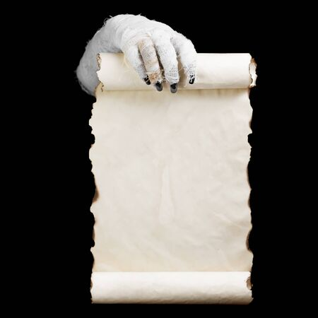 Mummy in hands keeps vertical manuscript on dark  background. Space for text.