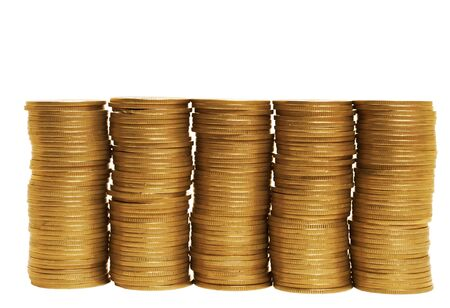 Stacks of coins standing in one row on white background