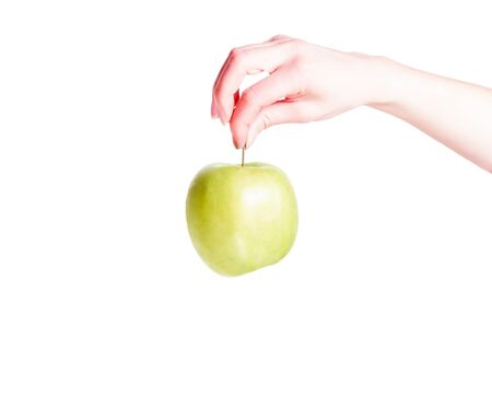 Close-up. Woman holding a big green apple isolated on white background