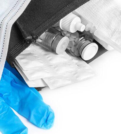 Medication, syringe, bandages, gloves, mask close-up