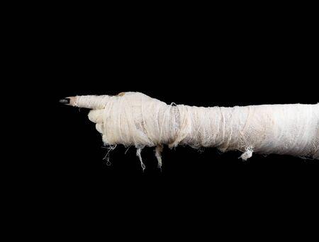 Hand of mummy indicates on dark gradient background. The horizontal position Imagens