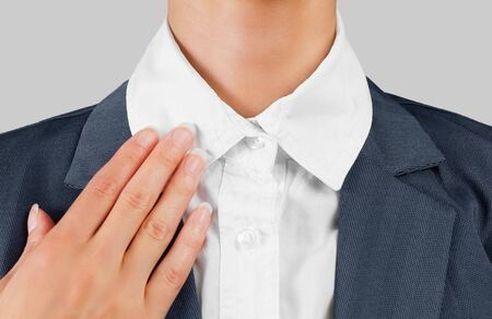 Unrecognizable female office worker holds white collar, close-up Stock Photo