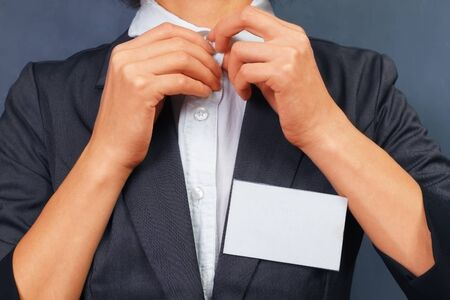 Unrecognizable business woman with empty badge on the chest, space for text