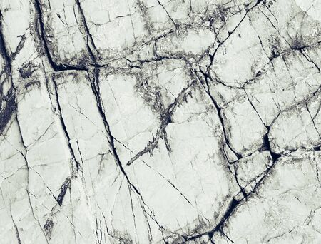 Rocky stone surface with cracked, texture