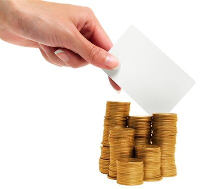 Female hand holding a card on a background of gold coins