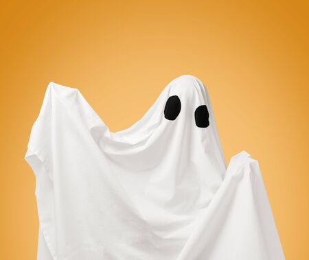 Cute white ghost with black eyes on a white background. Costume from sheet for Halloween holiday.