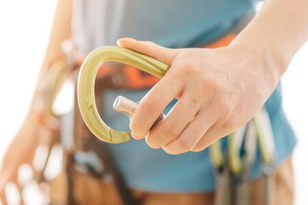 Climber sporty woman holding snap hook carabiner, close-up of hand. Stok Fotoğraf