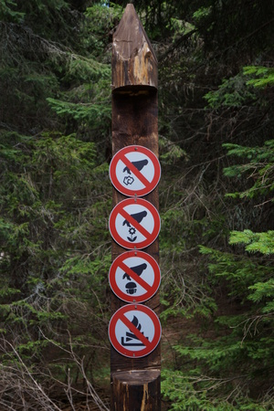Signs in a forest showing signs of prohibition Stock Photo