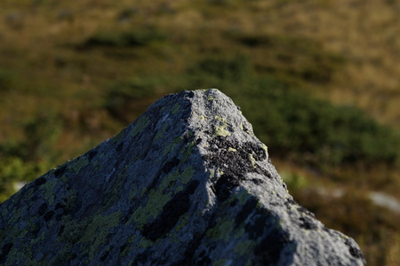 A rock tip on a mountain top