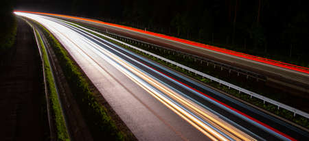 Night road lights. Lights of moving cars at night. long exposure multicolored