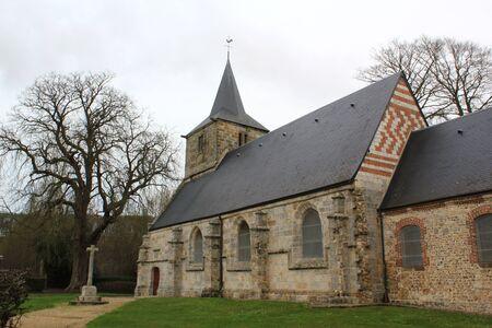 calvary: Calvary and Romanesque church, France Stock Photo