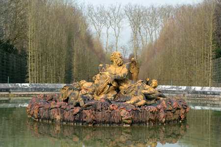 Versailles Palace: sculpture and fountain in the park Editorial