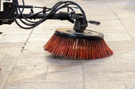 scavenging: Vehicle sweeping the streets of dirt in the Spain
