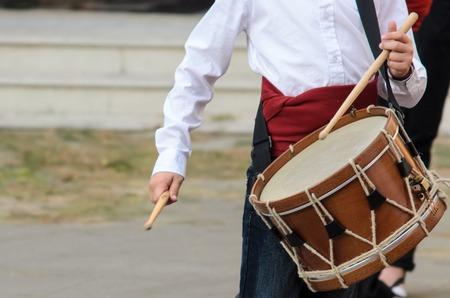 rhythm rhythmic: Drums player in group at parties in Spain