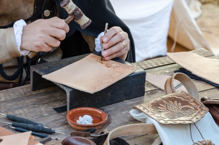 repairer: work table with old tools of the artisan shoemaker