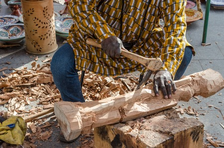 gouge: hands of the craftsman carve with a gouge
