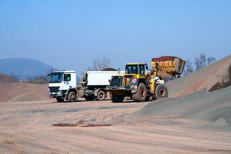 Heavy bulldozer loading ballast on the lorry Stock Photo - 4951673