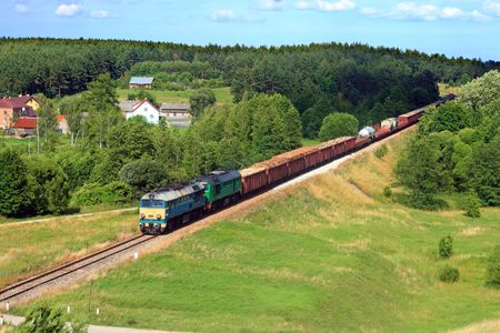 goods train: Rural summer landscape with freight train hauled by two diesel locomotives running through the countryside