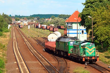 diesel locomotives: Two diesel locomotives shunting and sorting the wagons at the freight yard