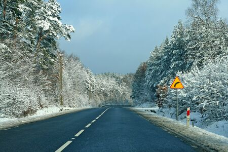 Road with curve ahead, wintertime Stock Photo