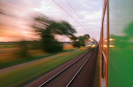 Two trains passing in opposite directions with motion blur photo