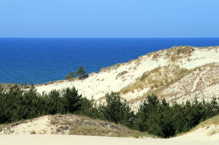 Landscape with sand dunes, forest and the sea at Leba - Poland Stock Photo