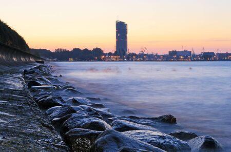 Stony sea coastline and quay in Gdynia, Poland photo
