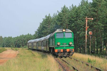 Passenger train passing through polish countryside