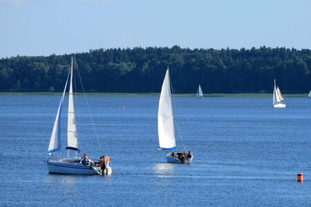 Yachts sailing on the lake under colorful sky Stock Photo - 5470713